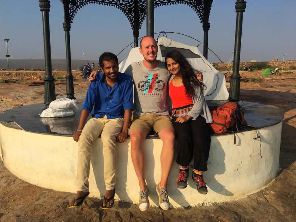 Rowan, Priya and Kesava sitting by our tent