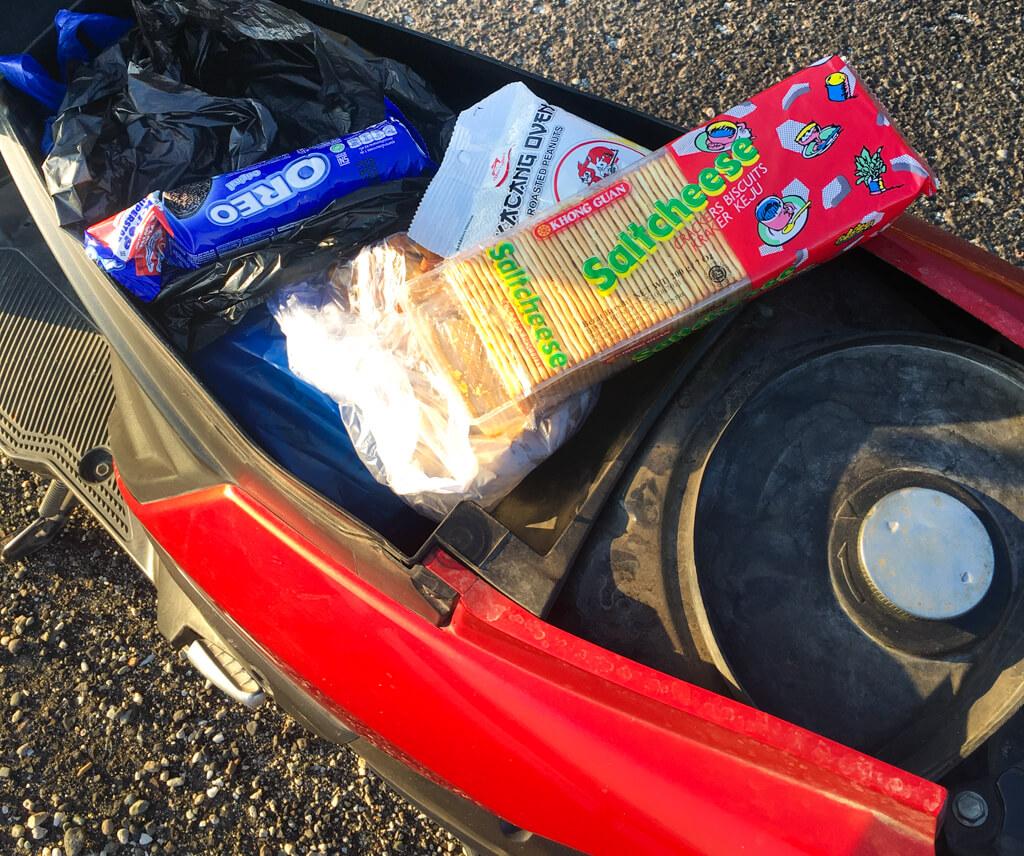 Packets of unhealthy snacks lying inside my bike.