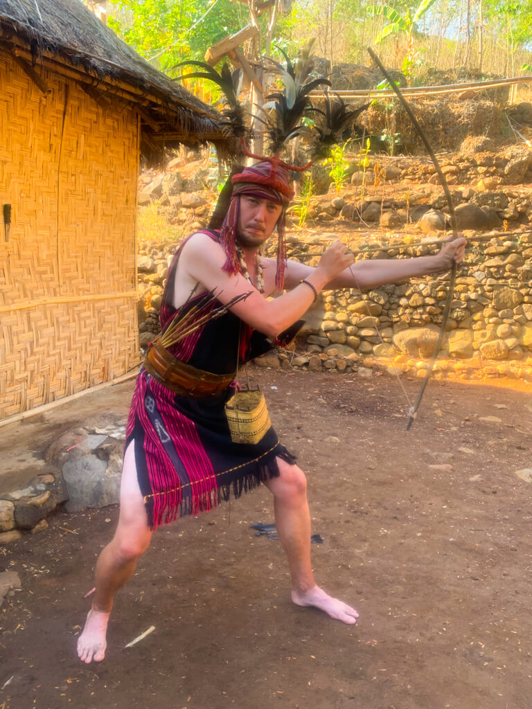 Me, wearing traditional tribal costume, with a bow and arrows.