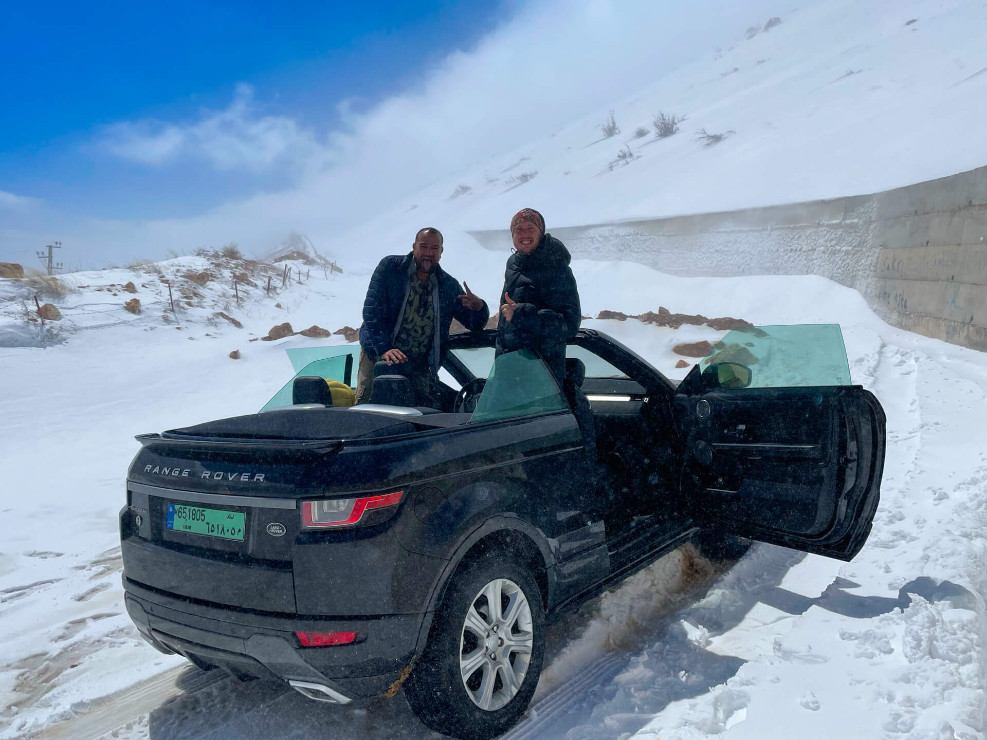 Reza and I posing on the convertible in the snow.