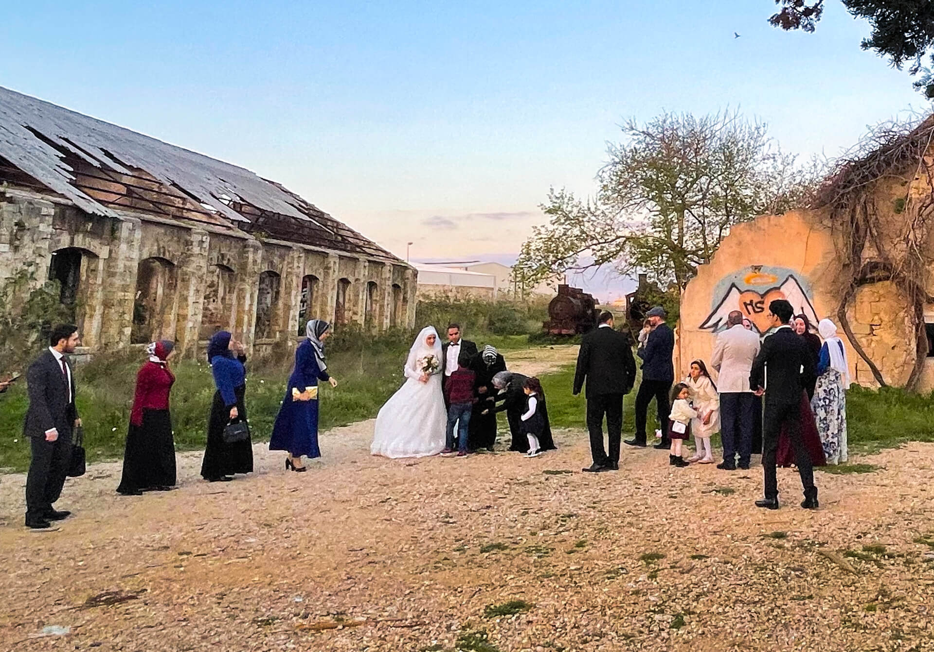 A wedding party taking photos in the old station