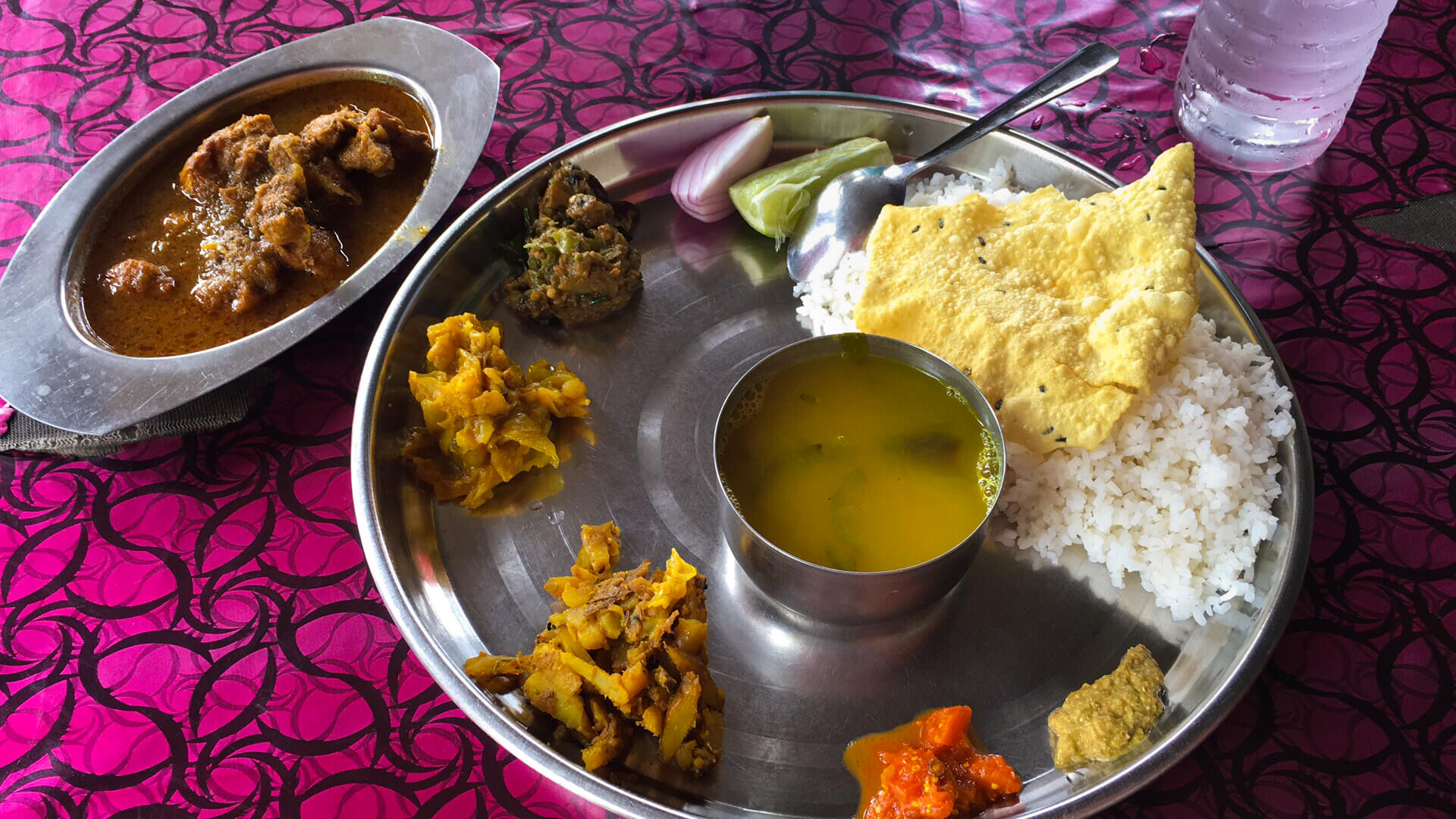 A large plate of India food
