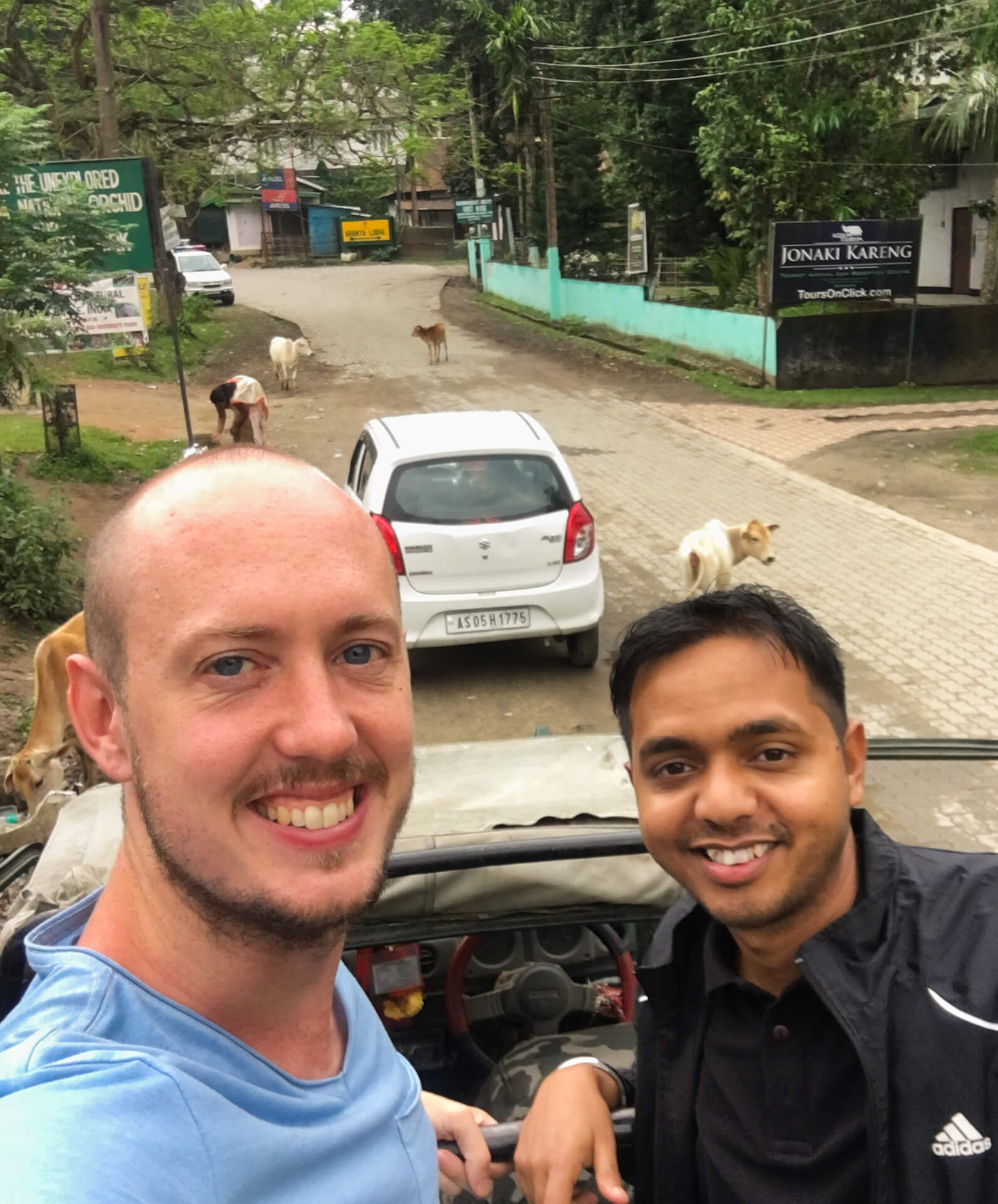 Rupam and I standing in the back of our safari vehicle on a street before entering the national park.