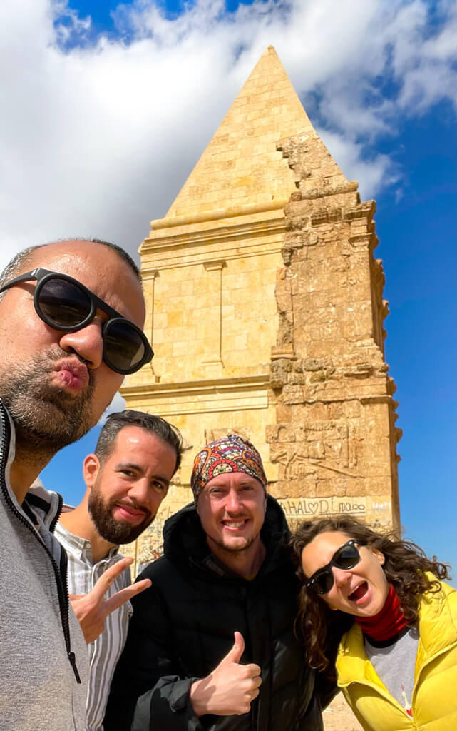 The four of us standing in front of Kamouh el Hermel