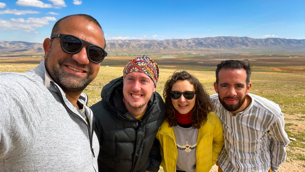 The four of us posing in front of the plains in the Hermel area.