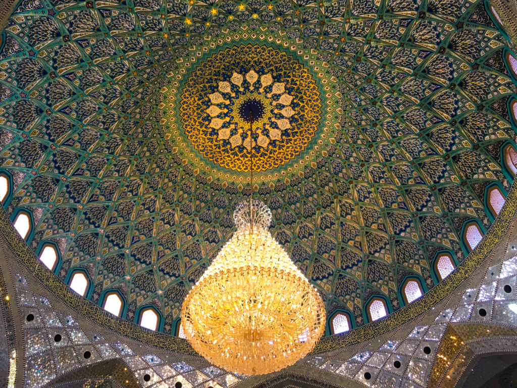 Brilliantly patterned inside of the dome with an ornate chandelier hanging below