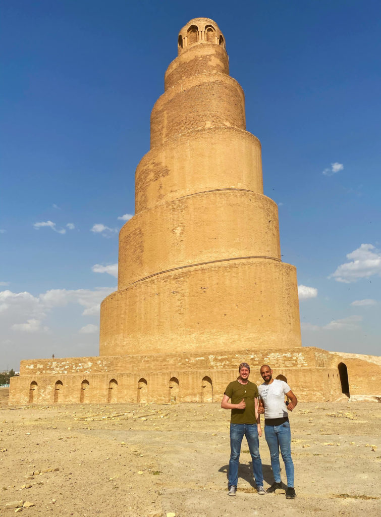 My friend Zeid and I standing in front of the minaret of the Malwiya mosque.