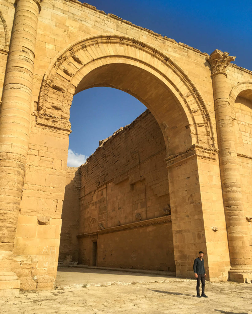 Huge arch with an Iraqi friend standing in front