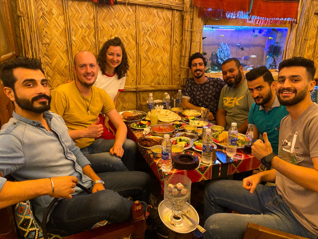 Me, Anna and a group of new friends from the Iraqi Traveller's Cafe eating in Darbunah restaurant in Baghdad.