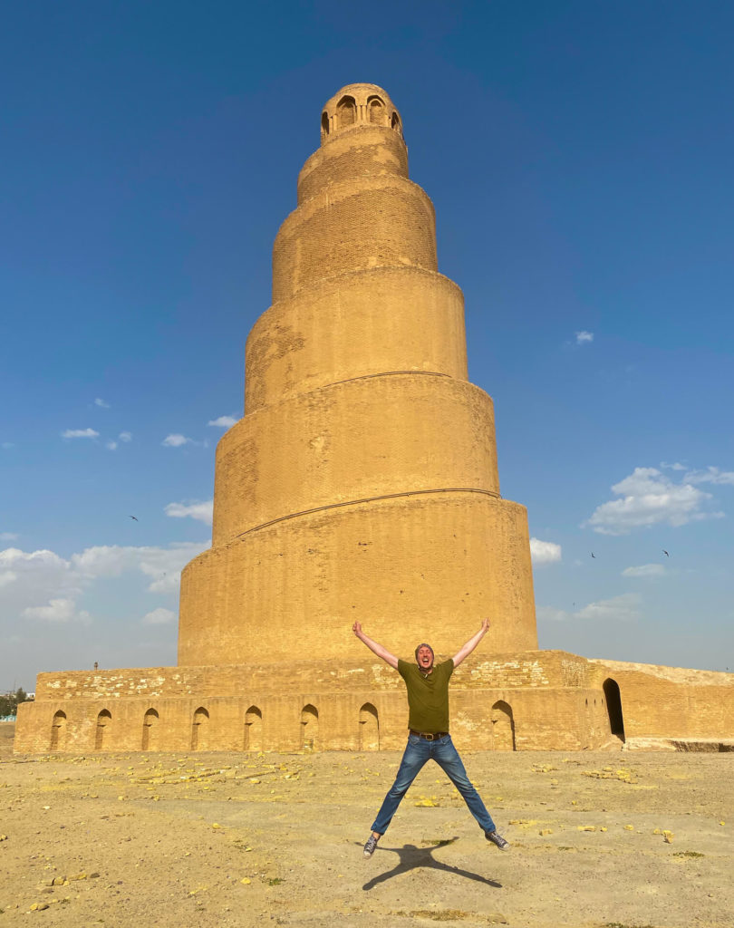 Me doing a star jump in front of the Malwiya Minaret.
