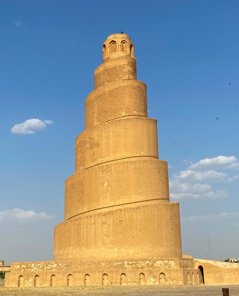 The Malwiya Minaret with a person standing on top.
