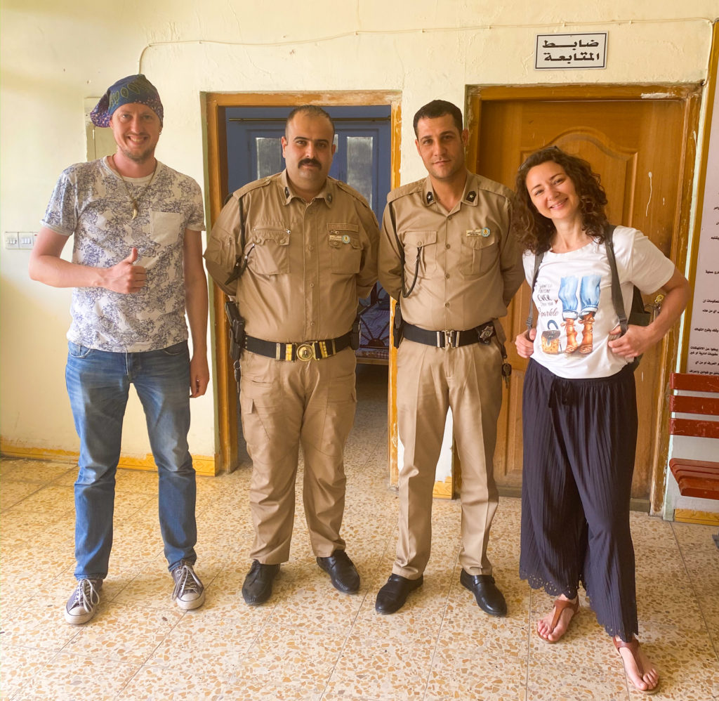 Me and Anna posing with some smiling security guards in Kirkuk.