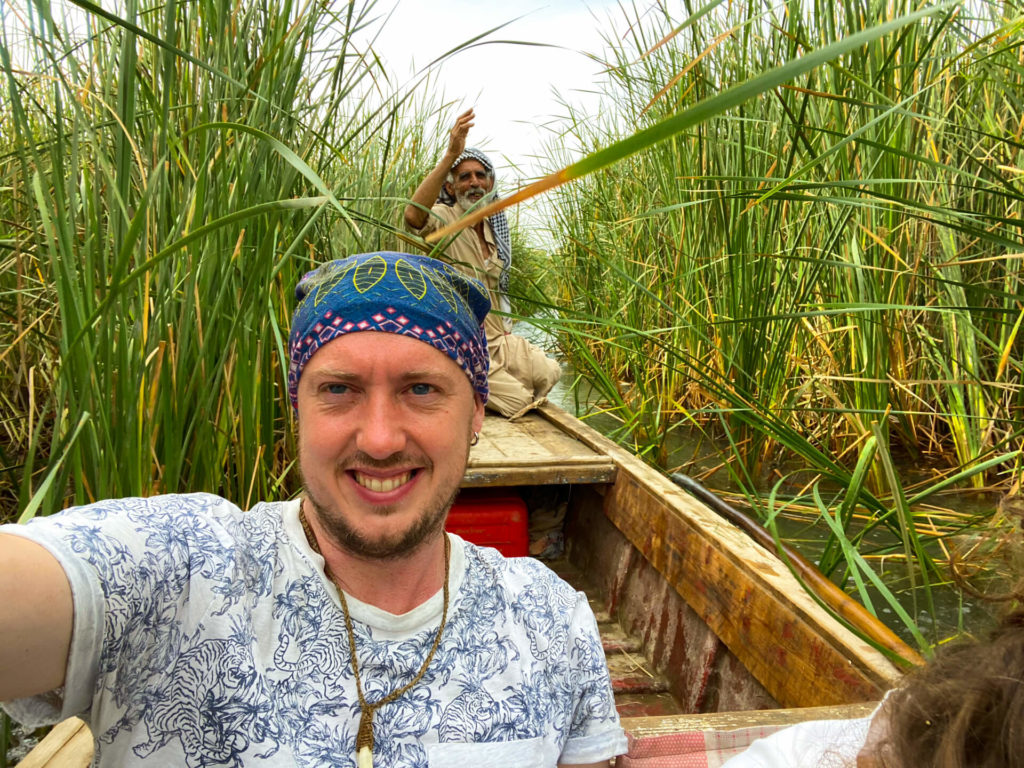 me in a boat travelling through the Mesopotamian marshes.