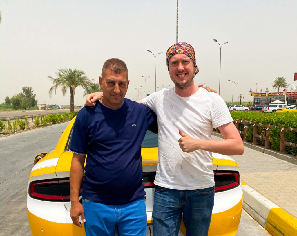 Me and an Iraqi taxi driver posing in front of his taxi
