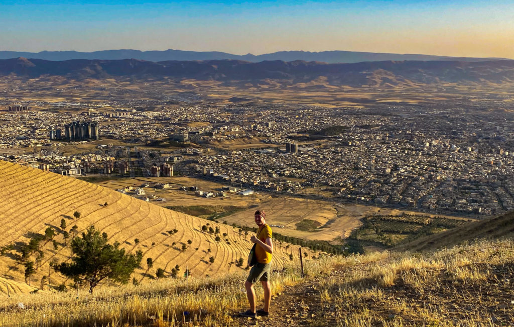 Me standing on Mt. Amzar with Sulaymaniyah in the background at dusk.