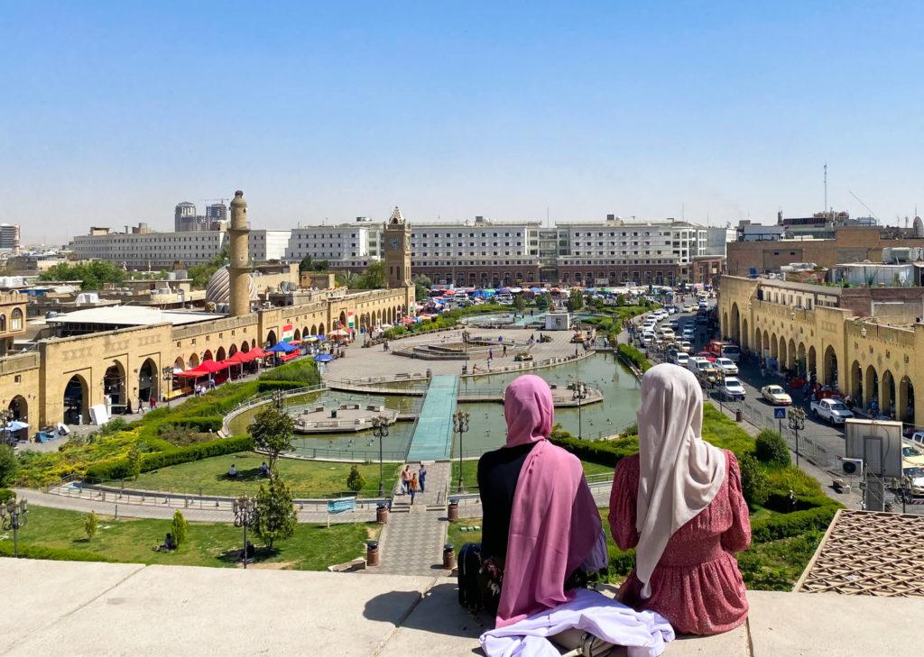 Two Iraqi girls admiring Erbil's main square from the citadel.