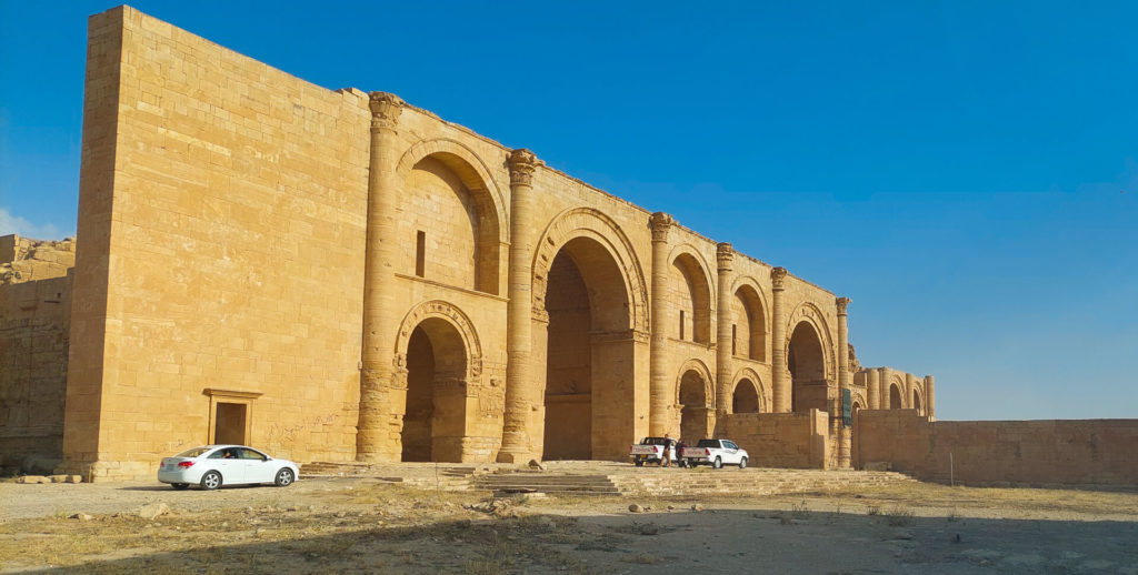 The main building of Hatra with our cars parked out front.