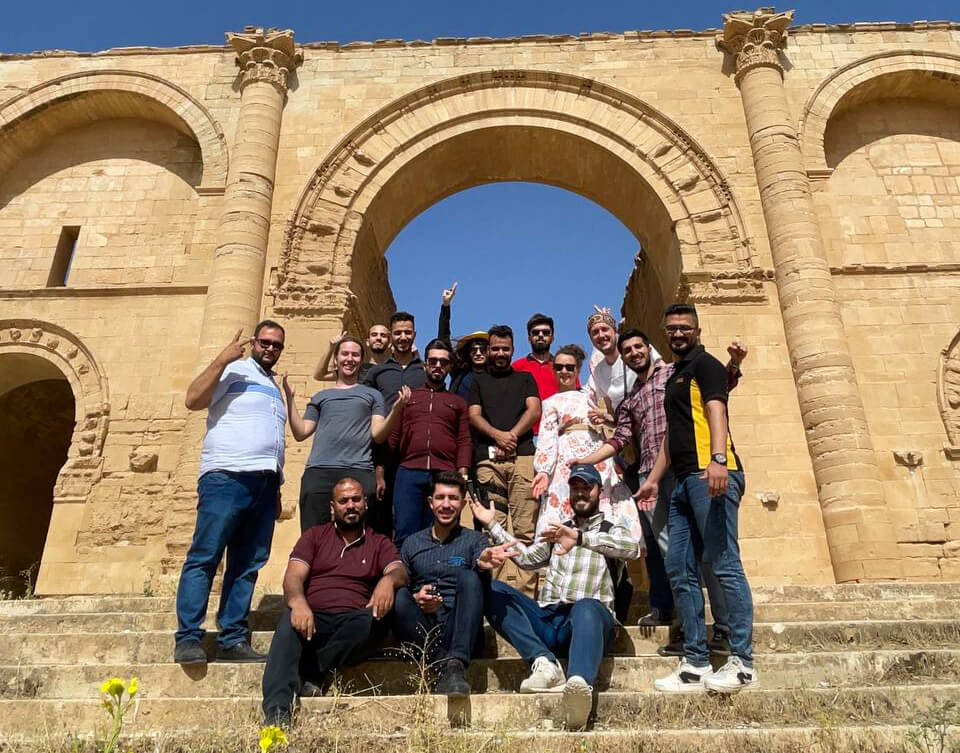 Me, Anna and our new friends in front of the main arch of Hatra.