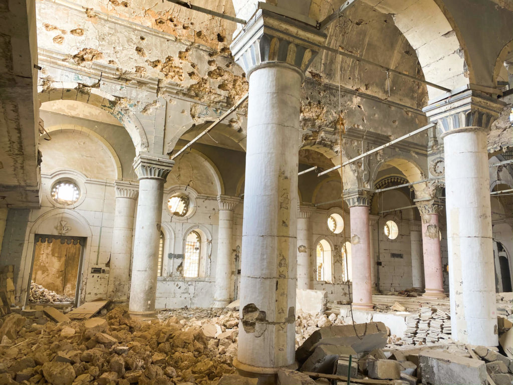 The remains of the Al Tahira church with bullet holes in the walls.