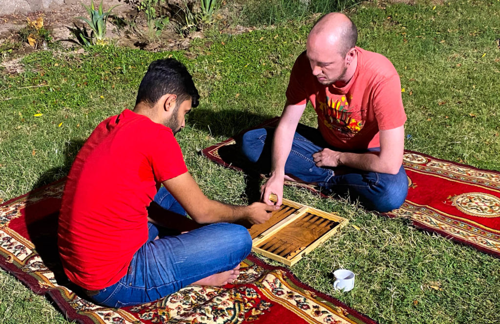 Me and a friend of Haydir's playing backgammon in Haydir's family's garden.