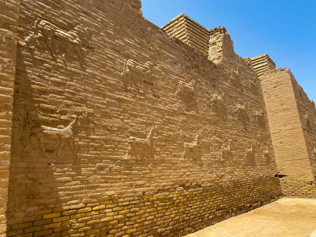A section of the lower part of the Ishtar gate, made of brick, with carvings of Marduk.