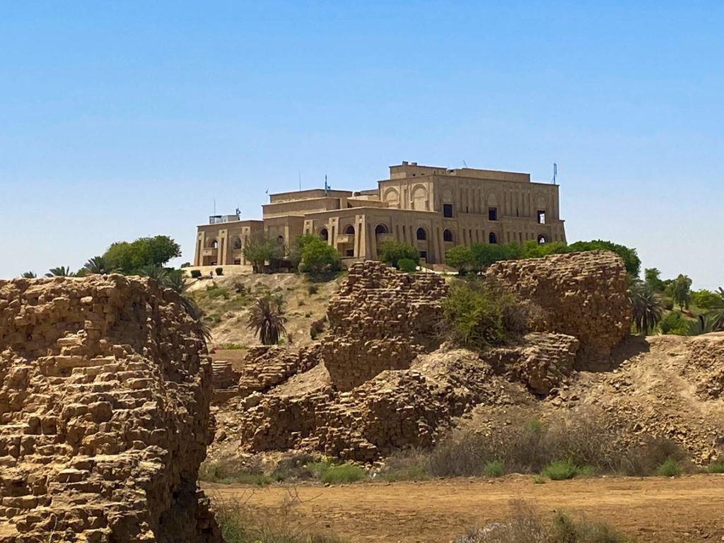 Saddam Hussain's summer palace sitting on a hilltop, viewed from the ruins of Babylon.